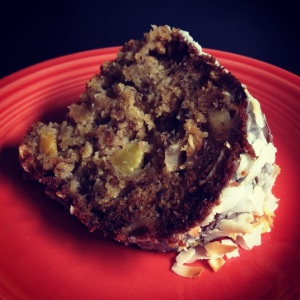coconut bundt with orange & chunks of candied ginger