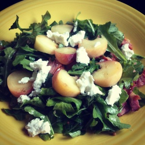 arugula salad with peaches, goat cheese and bacon
