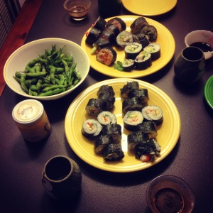 our dinner: four rolls, steamed edamame and hot sake