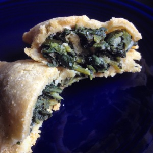 empanada with dark greens  and cheese