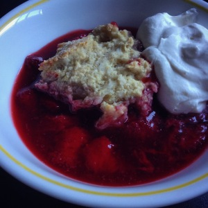 strawberry cobbler with cream cheese biscuits and whipped cream