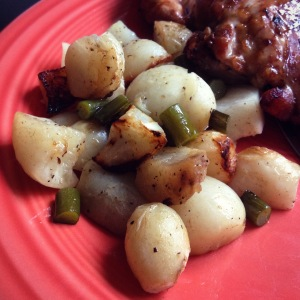 Grilled salad turnips with garlic scapes