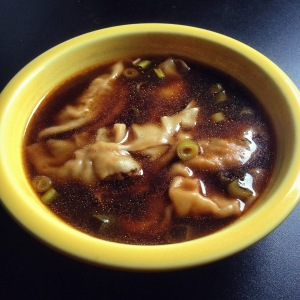 Comforting savory broth, with spicy pork dumplings